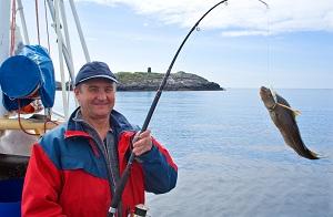 Pêcheur et son poisson